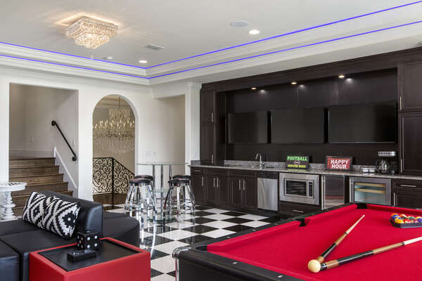 The games room has a wetbar, wine cooler and microwave so you don`t miss a single moment of the big game