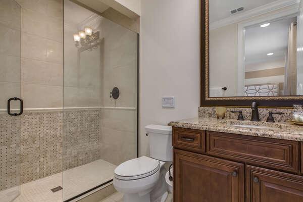 The en-suite bathroom has a walk-in shower