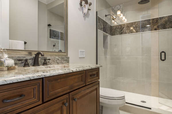 Enjoy a rainfall shower head in this en-suite bathroom