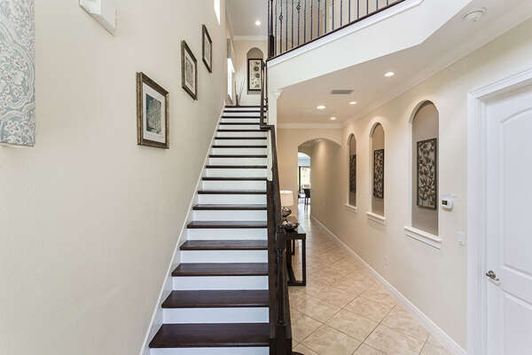 The foyer is welcoming with high ceilings and a beautiful staircase