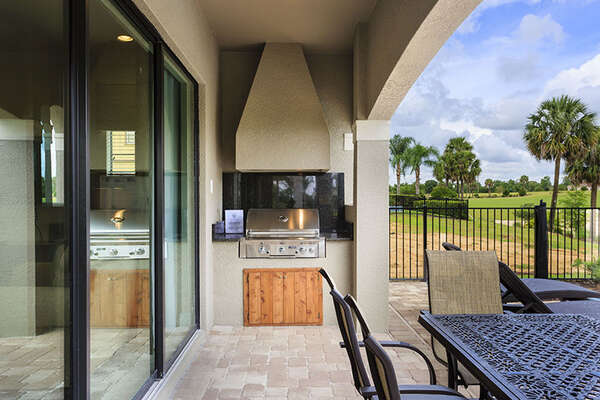Enjoy dining and cooking alfresco with the summer kitchen
