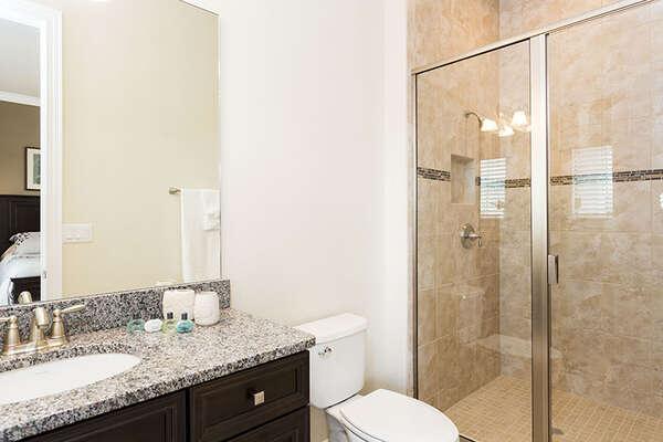 The second master en-suite has a glass enclosed shower