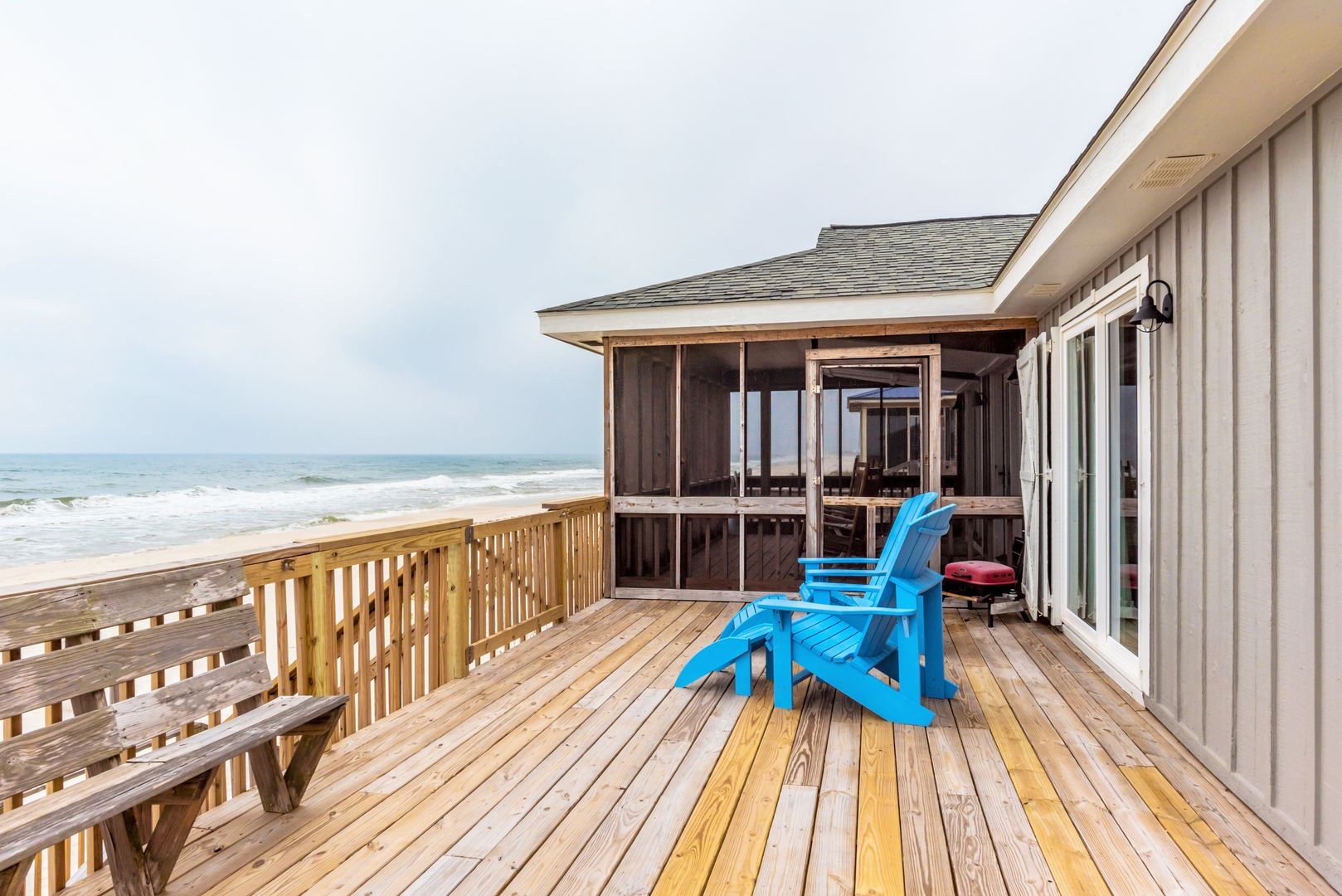 Sun deck and screened porch at this beach house rental in Gulf Shores, steps from the water!