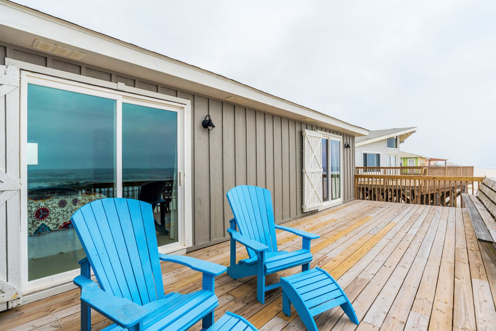 Relax with a Book on the Deck of this beach house rental in Gulf Shores