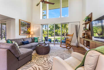 Living Area with Rocking Chair, Sofas, Smart TV, and Ceiling Fan