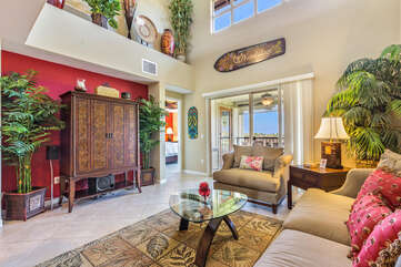 Living Area with Plants, Entertainment Center, and Lanai Access