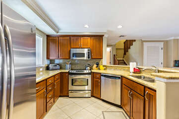 Full Kitchen with Stainless Steel Appliances and Wood Cabinets at Waikoloa Hawaii Vacation Rentals
