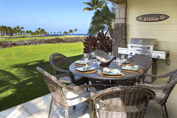 Lanai of this rental with grill and seating.