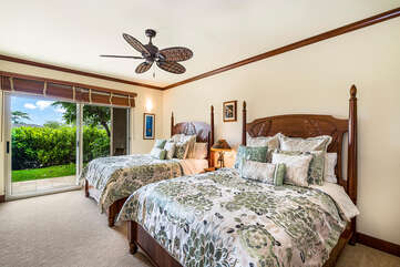 This dual queen master has Hawaiian style beds