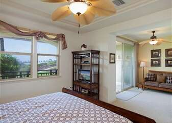 Spacious Bedroom with Sofa, Large Bed, and Ceiling Fans