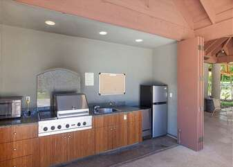 Common Area with BBQ, Refrigerator, and Microwave