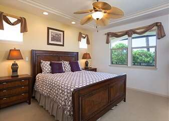 Bedroom with Large Bed, and Ceiling Fan