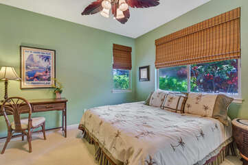 Bedroom with Large Bed, Ceiling Fan, Desk, and Chair