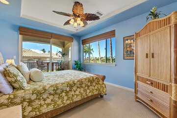 Bedroom with Balcony, Large Bed, and Ceiling Fan