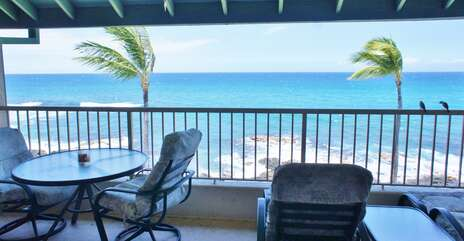 Oceanfront lanai with table and chairs