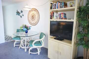 Dining table, chairs, and smart TV
