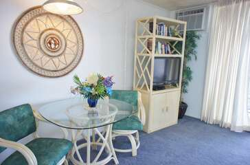 Dining room set for two, smart TV and an AC
