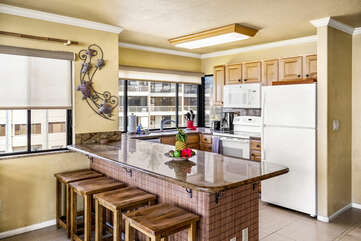 A breakfast bar and the kitchen