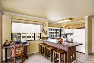A desk, a breakfast bar and the kitchen
