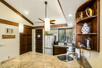 Full Kitchen with Stainless Steel Appliances and Marble Counter Tops