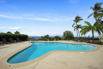 Pool with Lounge Chairs and Ocean Views at Kona Hawaii Vacation Rentals