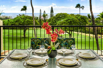 Dining Area with Table Settings on the Lanai Overlooking the Golf Course and Ocean