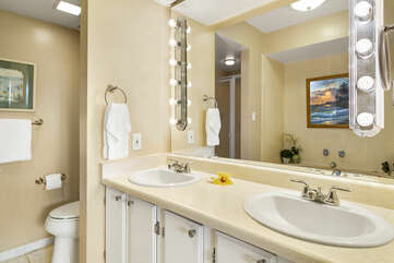 Bathroom includes dual sinks, tub and a walk-in shower.
