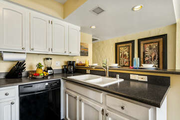 Fully equipped kitchen with dishwasher and sink.