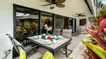Lanai with outdoor seating at this Kona Condo rental oceanfront.