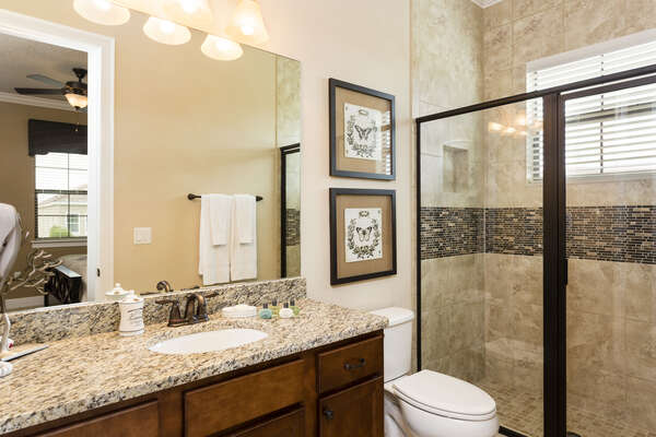 The second master bathroom offers a glass enclosed shower