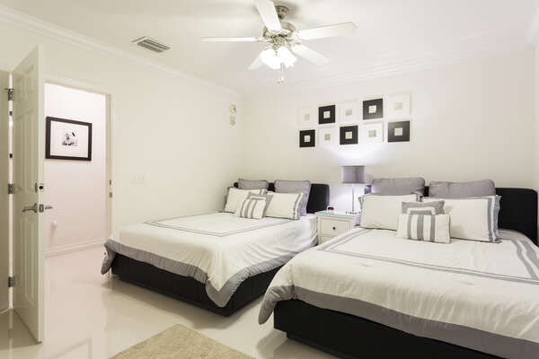 Second bedroom with two full size beds