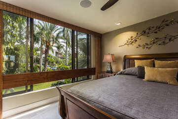 Guest Bedroom with King Bed and Tropical Views