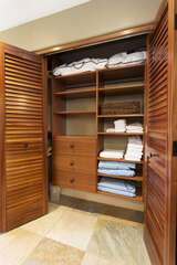 Master Bedroom Custom Closet with Mahogany Doors
