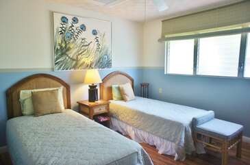 Bedroom 2 includes 2 twin beds
