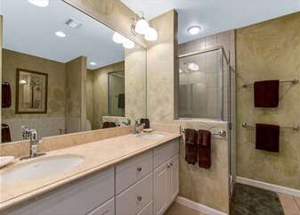 Master Bathroom with Double Sinks and Tiled Shower