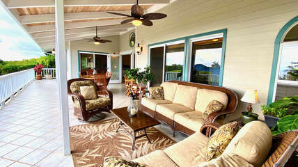 Large covered lanai with living and dining areas