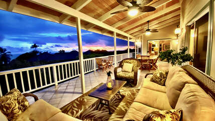 Large covered lanai with ocean and sunset views