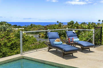Two Lounge Pool Chairs by the Pool with Ocean View