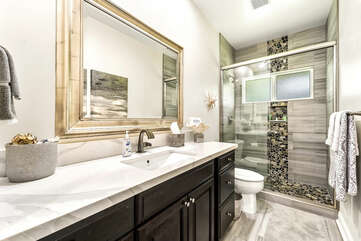 Bathroom with Shower, Single Sink, and Toilet