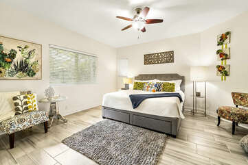 Bedroom with Large Bed, Ceiling Fan, and Accent Chairs