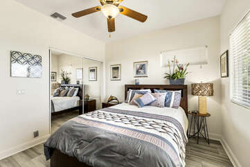 Large Bed, Ceiling Fan, and Mirror Closet Doors