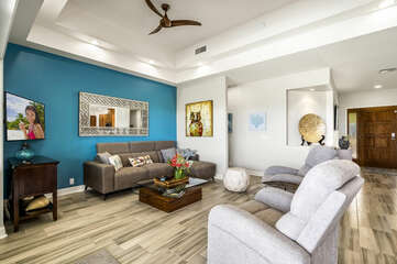 Sofa, Armchairs, Coffee Table, Ceiling Fan, and Smart TV