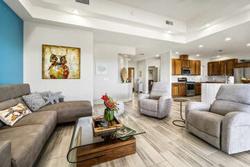 Sectional Sofa, Coffee Table, Armchairs, and the Kitchen