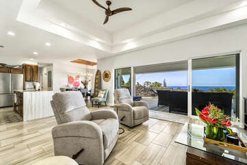 Armchairs, Ceiling Fan, and Sliding Doors to the Covered Lanai