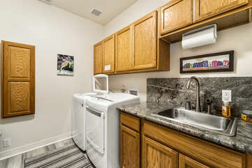Laundry Room with Washer, Dryer, and Sink