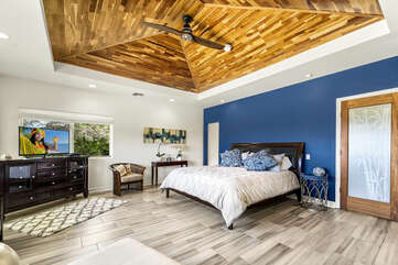 Large Bed, Ceiling Fan, and Smart TV