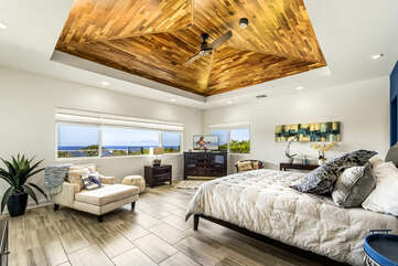 Bedroom with Ocean Views, Large Bed, Smart TV, and Chaise Lounge