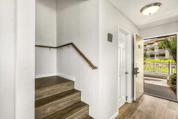 Unit entry, powder room & Stairs leading to bedrooms