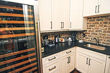 Butlers pantry off the kitchen features a Large Sub Zero Wine Frig, Coffee station.