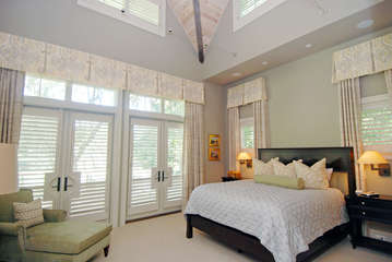 Retreat to the luxurious master suite with a king bed and deck access.